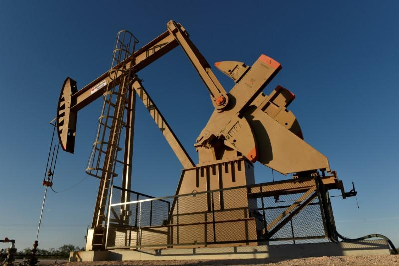 FILE PHOTO: A pump jack on a lease owned by Parsley Energy operates in the Permian Basin near Midland, Texas U.S. August 23, 2018. Picture taken August 23, 2018. REUTERS/Nick Oxford